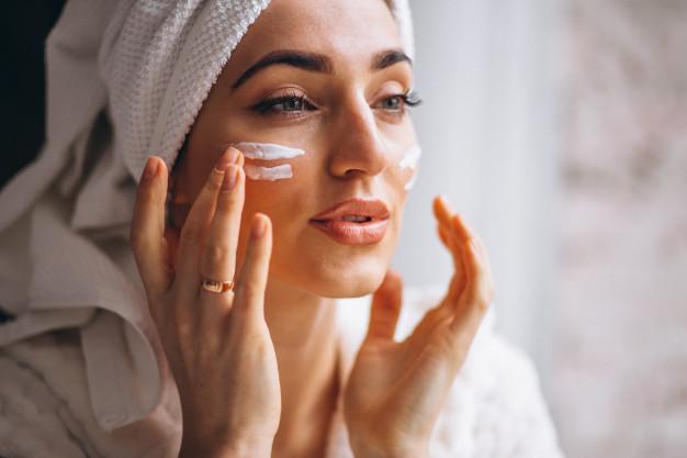 woman applying face cream 1303 14312